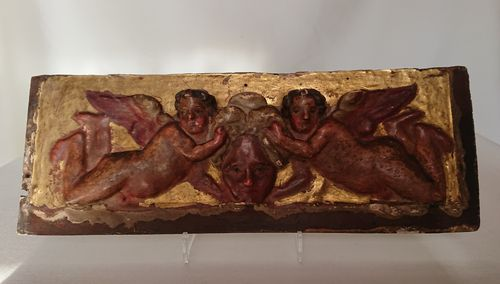 Gilt and red carved panel, Italy, first half of the 18th century