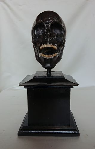 Wooden vanitas skull on pedestal, 18th century